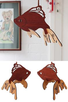This beautifully Goldfish Baby Mobile is laser-cut from native timbers such as Tasmanian Oak, Jarrah, Blackwood and Silky Oak. The different tones of these woods create contrast and enhance the movement. Great gift for children and for those who love the sea.