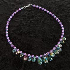 Fashion Week predicted a few striking jewellery pieces that'd reign victorious this summer, so let's look at the top trends in the jewellery making world. #craft #crafting #createandcraft #jewellery #jewellerymaking #diyjewellery #jewelleryprojects #necklaces #diynecklace #necklaceproject #beadedjewellery #purplejewellery #beadednecklace #purplenecklace