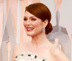Best Actress Oscar winner Julianne Moore needed nothing more than earrings with her magnificent Chanel Haute Couture strapless gown. Her diamond circles by Chopard made a statement all their own.