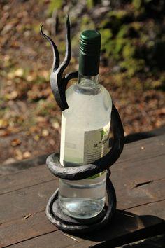 Hand forged Bacchus wine bottle holder