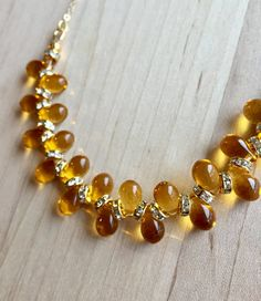 Shiny and luxe!  Gold Czech glass beads and Swarovski crystal gold plated rondelle beads on a gold filled chain.  Necklace measures 21 inches.