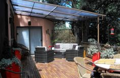 This is a remodel page, what I like is how it shows the addition of a privacy scren and shade awning, deck feeder… Our new deck! - Houzz