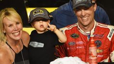 HOMESTEAD, FL - NOVEMBER 16:  Kevin Harvick, driver of the #4 Budweiser Chevrolet, celebrates with  his wife DeLana and son Keelan in victory lane after winning during the NASCAR Sprint Cup Series Ford EcoBoost 400 at Homestead-Miami Speedway on November 16, 2014 in Homestead, Florida.  (Photo by Patrick Smith/Getty Images)