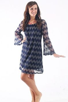 "Crocheted Cutie Dress, Navy $42.00 This is such a great game day dress for many teams! The love the crocheted look and the trendy chevron stripes. No worries ladies...this one is lined:) The sleeves do feature an open weave so you won't get too hott!   Fits true to size. Shelby is wearing the small.  From shoulder to hem:  small-38""  medium-38  large-38.5  XL-39"