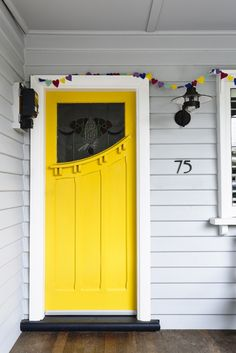 Unusual style of front door #exteriordoorstyles #shadesofyellowpaintcolours
