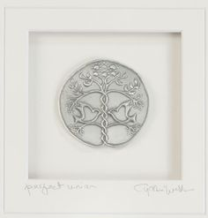 A Perfect Union Wall Art: This gorgeous, symbolic wall art is the perfect sentimental keepsake for newlyweds or couples celebrating a first Christmas together or older couples celebrating an anniversary. The pewter plaque and silver frame suit any taste or décor style.
