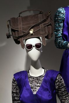 What a unique way to display a purse- on the head of a mannequin!  This is from Barney's