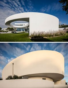 This modern house features a curved wall that wraps around from the front to the rear and opens to reveal a large elliptical cut-out.