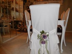 Purple roses use to decorate a shabby chic slip covered chair