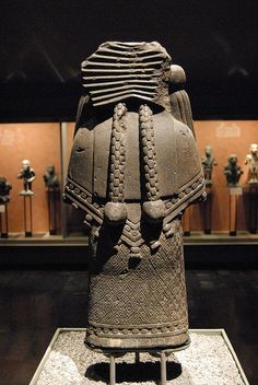 Chalchihuitlicue Her name means jade or turquoise skirt in Nahuatl and she's also the patroness of childbirth. Makes sense, water and chidbirht.The view of her back gives a clear view of the Aztec costume of...
