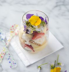 Strawberry Lemon Custard Trifle with edible flowers - BoulderLocavore.com...this recipe is not vegan but could easily be converted using a tofu lemon curd filling and using non dairy milk and egg replacemnts