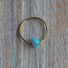 Silver Opal Nose Ring tiny OPAL nose Hoop opal by junelittleshop So cute! I need to find out what gauge mine is
