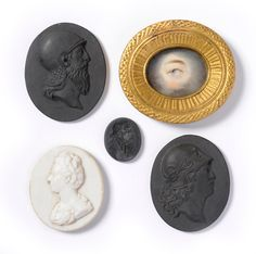 Tennants Auctioneers: A Pair of Wedgwood Black Basalt Portrait Medallions