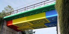 LEGO Bridge   | Inspiration |      Railway bridge in Wuppertal, Germany was painted to look like it was made out of colorful LEGO bricks.      Unique project was completed in 4 weeks by talented German street artist Martin Heuwold (aka MEGX).