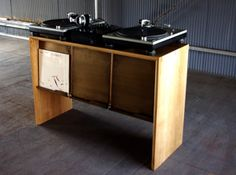 """Dj Booth"" Shown in Oak with Hand Rubbed Dark Oil Finish & Rusted Brass Plating Plate  Dimension W 1092mm x D 740mm x H 410mm    Vinyl records"