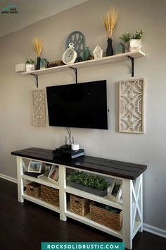 You can easily make this modern farmhouse console table following our tips and tricks. Then add wall decor and shelving to decorate around your tv! #consoletable #farmhousedecor #farmhouseconsole #modernfarmhouse #tvstand #entertainmentcenter