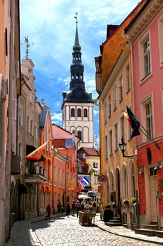 Street view of the Old Town in Tallinn, Estonia, with Niguliste Museum (St. Nicholas' Church). This medieval old town, a fairytale-like place, is one of the most popular travel destinations in the world and listed in the UNESCO World Heritage List.