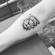 Tattoo lion man forearm
