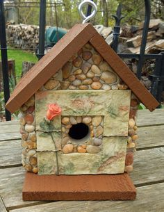 """Rose Bud Inn Cedar birdhouse with stones and river rock collected from the shores of Lake Michigan, local rivers and from creek beds and rose motif garden style surround opening. Roof and base is weatherproof stain in brown color.  Suitable for outdoor or indoor décor. Removable base for easy clean out.  9"""" high X 8"""" wide X 6"""" deep       1 1/4"""" opening  60.00 plus shipping"""