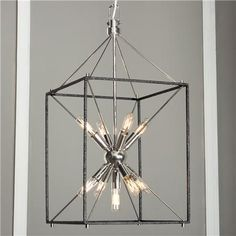 """Starburst Light Ray Hanging Lantern Light radiates from a starburst cluster of 9 mini tubular bulbs (included) inside a black iron cage. Polished Nickel or Aged Brass """"Sputnik"""" cluster adds a midcentury modern touch. 9x40 watt candle sockets (T6 E12 40 watt bulbs included). (30""""Hx16.25""""W)  4' chain, 6"""" diameter canopy."""