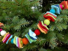 Finally, something with color and a fun natural texture. Each of my children can make their own for the tree. And we can work on pattern concepts. Better get us some felt and PomPons.