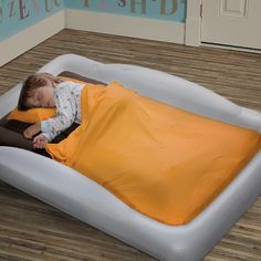 An air mattress with raised sides is brilliant for traveling with little kids!