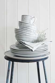 Set the table with striped dining ware and nautical mugs for a quiet, coastal look.