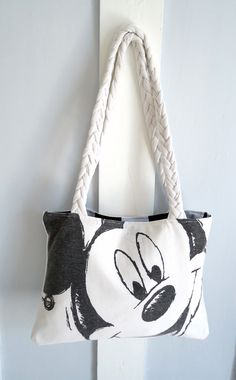 Upcycled t-shirt bag.  Could use an iron-on transfer if you don't have any t-shirts with Mickey on them that you're willing to cut up!