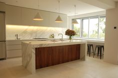Love the island bench and the matching marble in the splash back.