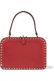 You know you love me. Rocking red rockstud leather beauty. Wonder how this beauty would look combined with some pastel tulle skirt and mickey mouse shirt.  Dream bag by Valentino