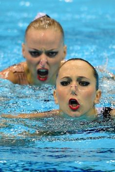 Synchronized Swimmers are terrifying.. haha they look like theyre gonna kill someone!