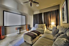Slightly attainable home theatre... love everything but the marble floor & rug... and throw blankets need to be a different color