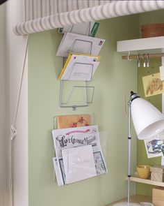 On the wall we used a pot lid holder as a mail sorter. If you're innovative, you can find office organization items anywhere. We often look in the kitchen or at hardware stores.