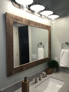 """Renewed Décor Shiplap Reclaimed Wood Mirror in 20 stain colors - Large Wall Mirror - Rustic Modern Home - Home Decor - Mirror - Housewares - Woodwork - Frame - Stained Mirror. Shiplap Reclaimed Wood Framed Mirror • Available in 3 sizes 24"""" x 30"""", 30"""" x 36"""" or 42"""" x 30"""" • 1/4"""" quality mirror glass •Frame approximately 3"""" thickness • Available in Horizontal or Vertical Mounting • screwed on saw tooth hangers are attached for easy hanging on any wall • Available in over 20 colors **Each…"""