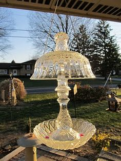 Bird feeders or bird  baths made out of pretty glass bowels and candle holders.        To put together you have to use liquid nails to glue them together.  You can hang them or sit them on something.