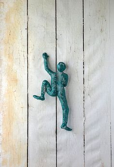 Contemporary metal wall art Climbing man sculpture by nuntchi