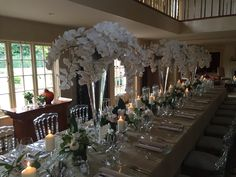 Weddings by www.blomsterdesigns.co.uk designed by Floral designer Russell New join us on Facebook instgram & Twitter. Green white flowers orchids