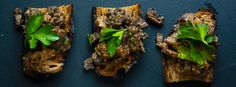 We put morels, our favorite spring mushrooms, on toasts with a little bit of parsley to make the perfect appetizer.
