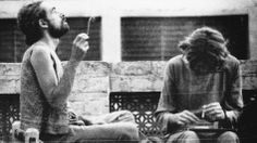 """Western tourists smoke hashish on the roof of a hotel in Peshawar in 1972. Pakistan was an important destination along the """"hippie trail,"""" a popular route for young Western backpackers that ran across Turkey, Iran, Afghanistan, Pakistan and India, usually ending in Nepal. (Courtesy of Nadeem F. Paracha)"""
