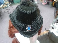 My newest Hat, handstiched black velvet with blue jewel accent and feather plume
