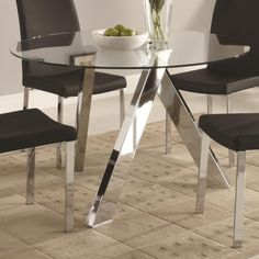 The Popularity of Glass Top Dining Table Bases Nowadays: Astonishing Modern Black Chairs And Round Glass Top Dining Table Bases With Chrome Interior Dining Room Ideas Also Fruit Bowl And Glass Vase ~ boholmain.com Dining Room Inspiration