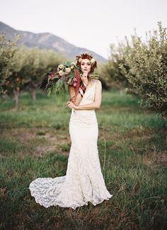 Gorgeous bohemian hand tied bridal bouquet. Bridal portrait