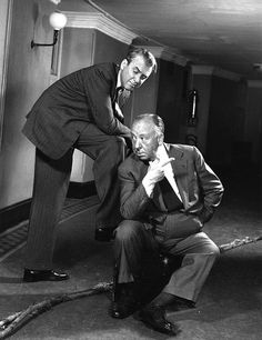 Alfred Hitchcock and James Stewart.