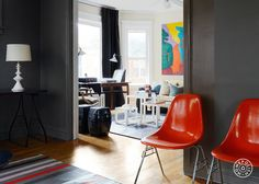 David's Fun House, Part 2 - Red chairs match the rug in this room and the painting in the next, creating cohesion between the separate spaces. They double as decoration and seating. by Homepolish Chicago https://www.homepolish.com/mag/davids-fun-house-2?utm_source=pinterest&utm_medium=profile&utm_campaign=david_2