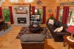 """Welcome to Bear Corner, a pretty two story, one bedroom log cabin located in the beautiful Hidden Springs Resort directly behind Dollywood and Splash Country.  The living room features a queen sleeper sofa, chair, cozy rocker and 42"""" Plasma Flat Screen TV with Direct TV  including HBO & local channels also included is VCR/DVD all in front of a warm gas log fireplace.  Gatlinburg/Pigeon Forge Tennessee"""