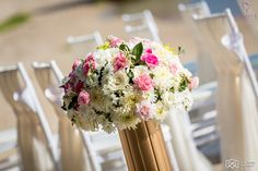 For Alex and Ramona's wedding, the theme was white and pink with accents of gold.  We used gold stands to house these beautiful white and pink floral displays.