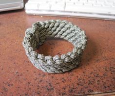 I love paracord, both for its countless uses and the fact that it looks really cool when woven into bracelets, belts, straps, etc. I work backstage and am always looking for a good way to carry a large amount of cord on me that can be easily accessed. I found The Slatts Rescue Belt and decided to see if I could weave one into itself without using a buckle. The results came out to be a nice looking bracelet that can be undone in a matter of seconds.