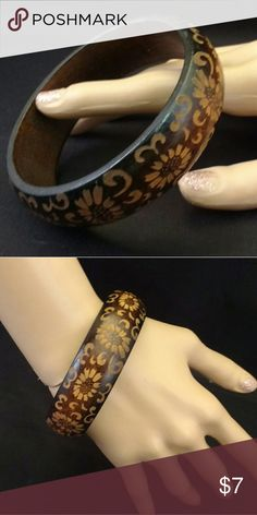 Wood Bangle BraceletDecorated in flowers This is a wood bangle bracelet stamped in gorgeous sunflower style floral design. The decor is so well done that the flowers look etched in. Jewelry Bracelets