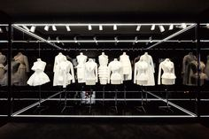love the stark white garments against the pitch black background. Esprit Dior Exhibition Tokyo by Bureau Betak