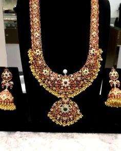 A lot of significance is given to the jewellery we wear. This haar is combination of Flowers & Peacock Flower… [Video] Jewelry Design Earrings, Gold Earrings Designs, Gold Jewellery Design, Indian Bridal Jewelry Sets, Silver Jewellery Indian, Dubai Gold Jewelry, Whatsapp Messenger, Flower Symbol, Fashion Jewelry